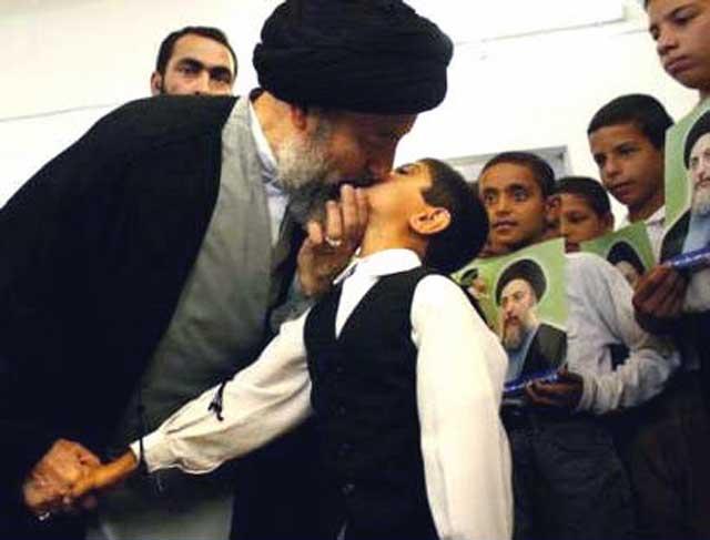 muhammad-baqir-al-hakim-kisses-boy-on-lips-on-arrival-to-supreme-council-najaf-iraq