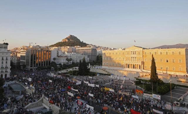 protesters-gather-in-front-of-the-greek-parliament-during-an-anti-austerity-rally-organized-by-the-country-s-biggest-public-sector-union-adedy-in-athens.jpg