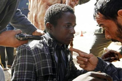 A young African on the conveyor belt to a mass grave, courtesy of Western media and politicians